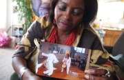 Sala-Haquekyah Chandler holds a photo of her late son, Yalani Chinyamurindi, dancing while she plays the drums.