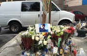 A memorial for shooting victim Hector Salvador set up at the scene. Photo by Joe Rivano Barros