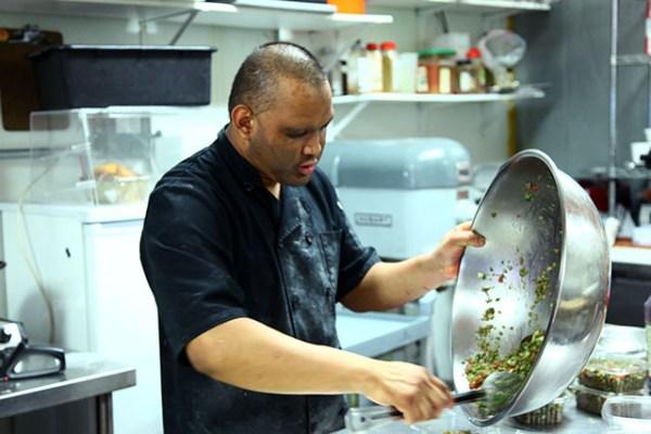 Aldo Sanchez is a line cook at Venga Empandas at 433 Valencia St. Photo by Laura Waxmann
