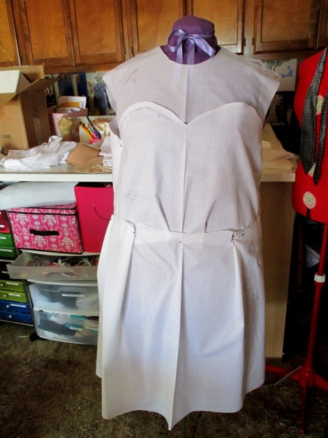 Muslin pattern pieces pinned to my dressform