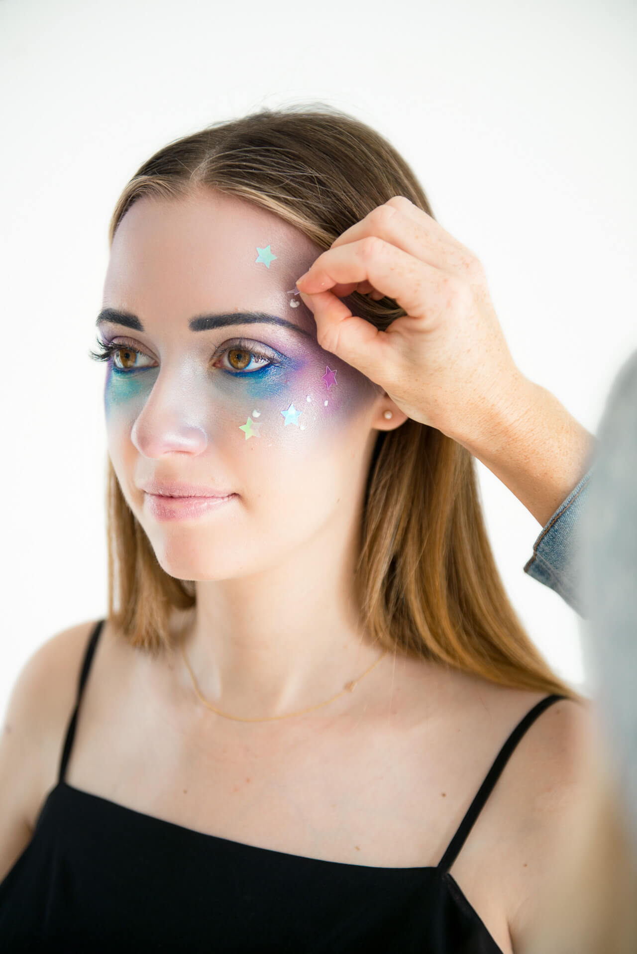 add stars to face for Galaxy Girl Makeup Tutorial
