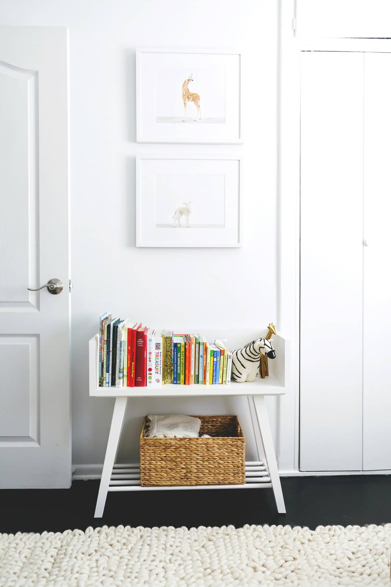 a cute white bookcase in a nursery