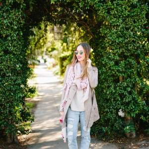 suede jacket with distressed jeans and pink scarf