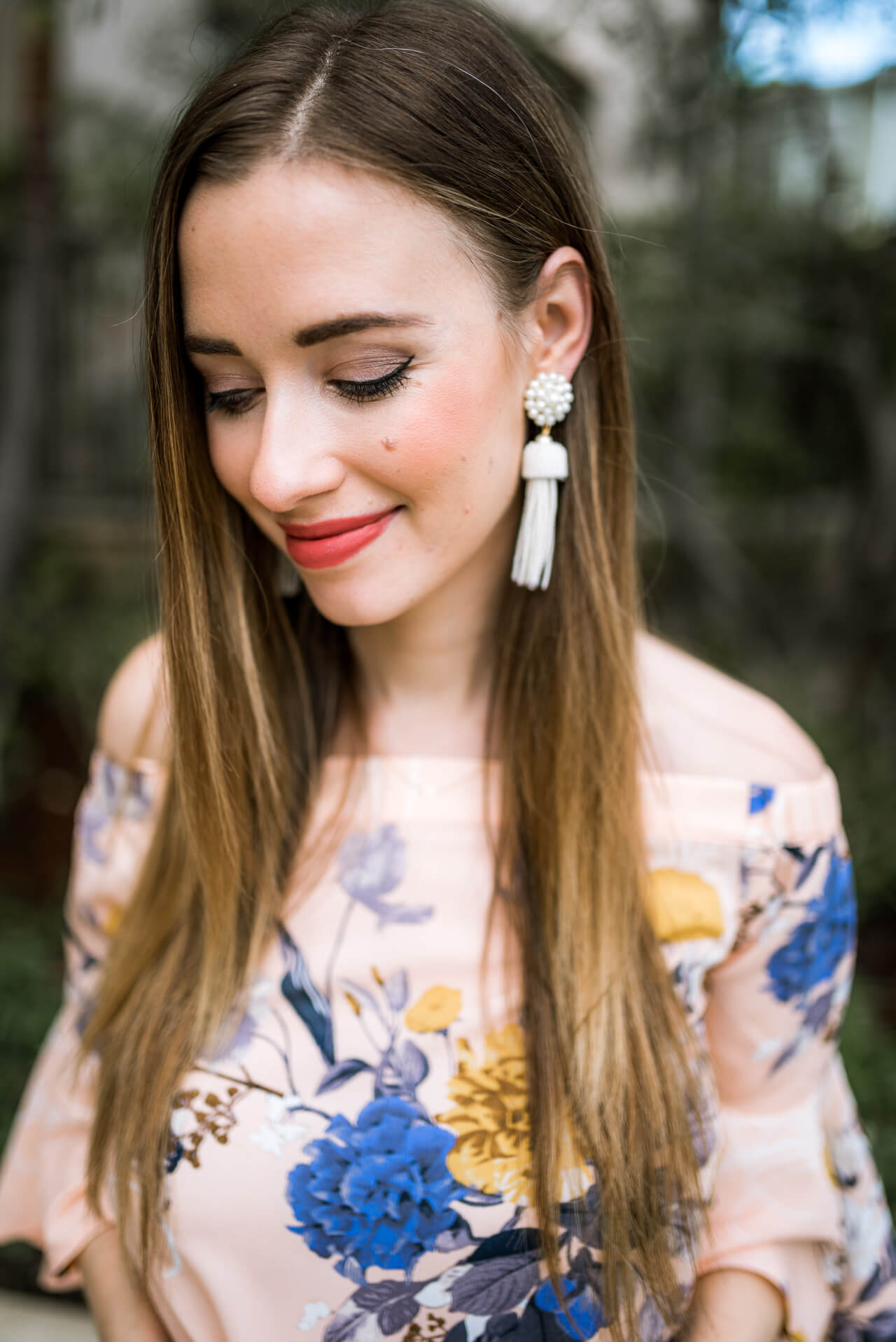 white beaded tassel earrings with off the shoulder top