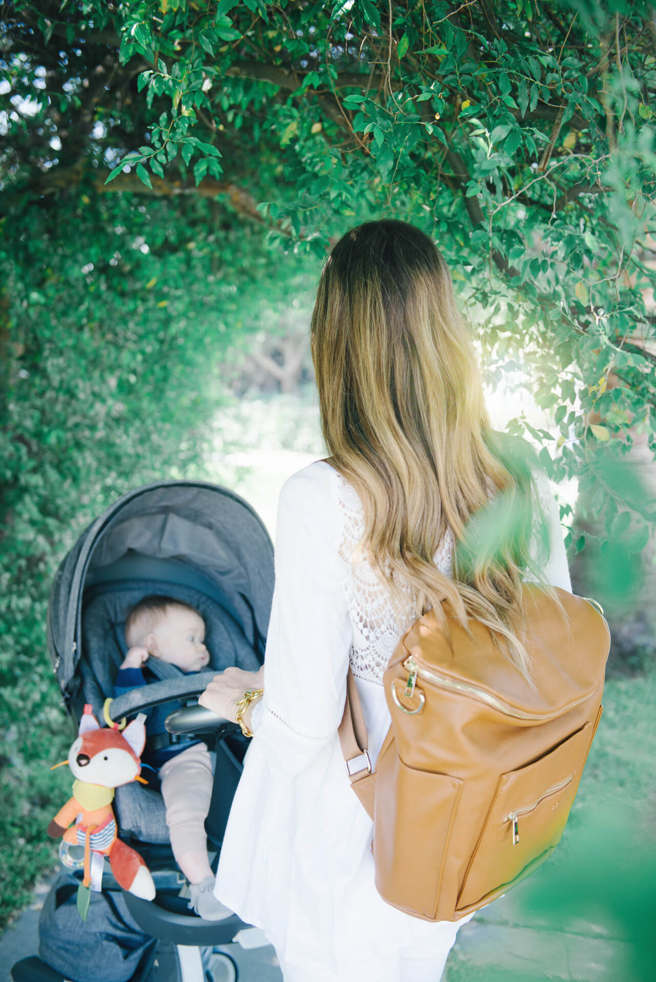 love this chic brown diaper backpack