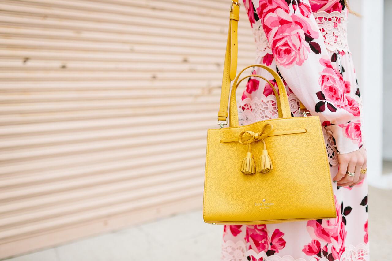 rose print dress with mustard tassel bag