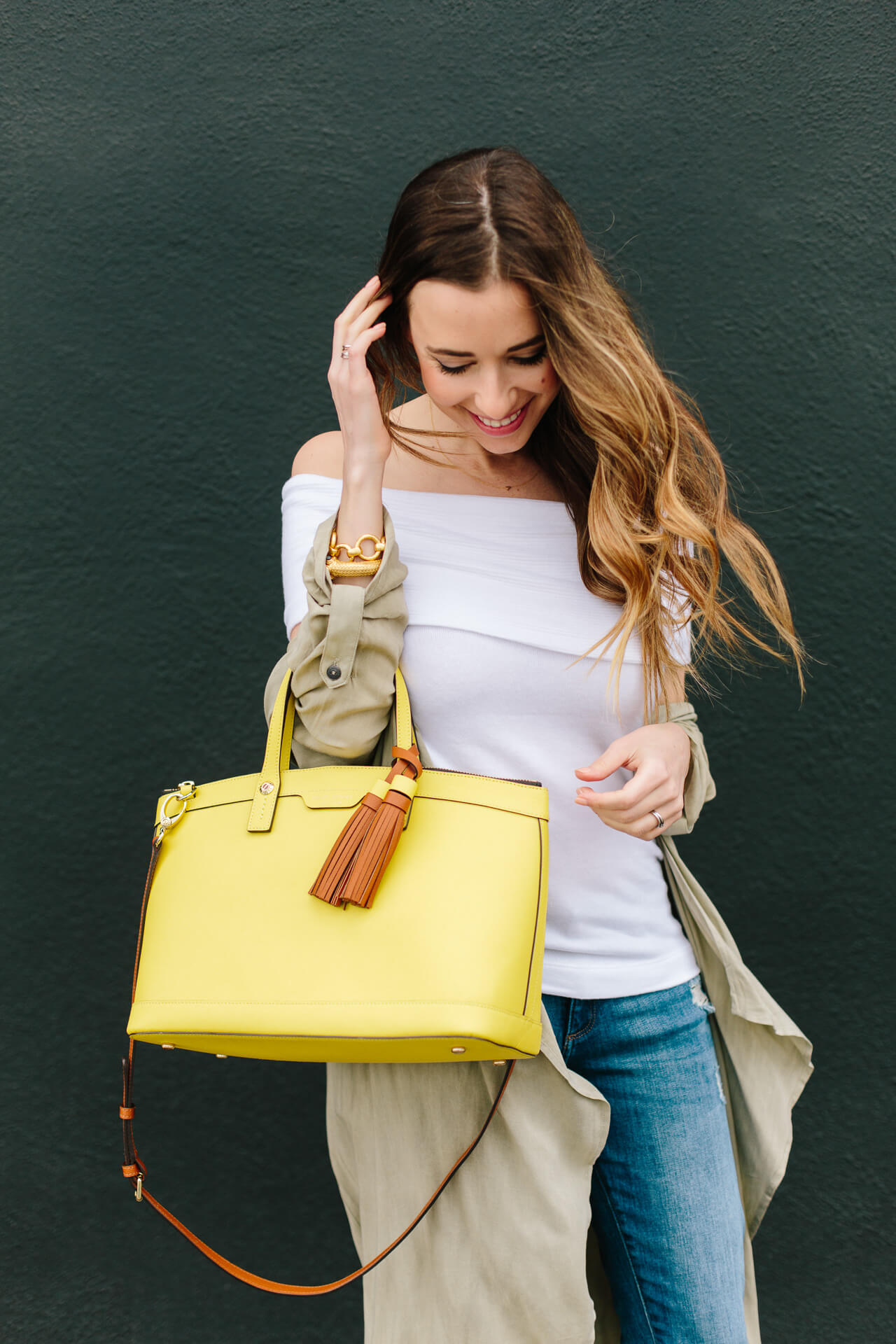 white off the shoulder top with yellow bag