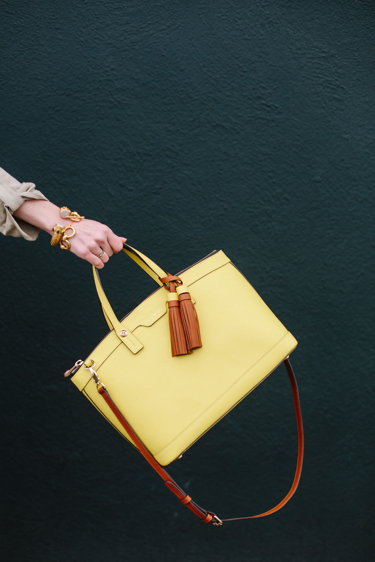yellow bag with tassels