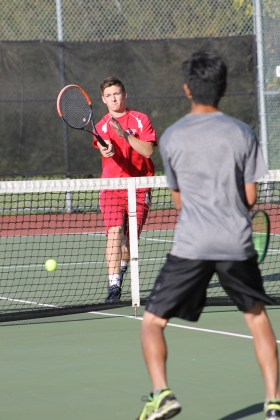 Mountlake Terrace's Adam Lorraine (left) hits a winner in Monday's #1 doubles match at Mountlake Terrace High School. Lorraine and doubles partner Max Leidig defeated Meadowdale's Kristoph Ty and Djelli Berisha 6-1, 6-2.