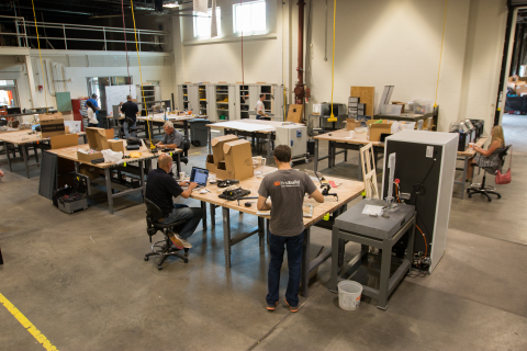 The FirstBuild lab features an electronics prototyping center, laser cutter, hardware components and ...