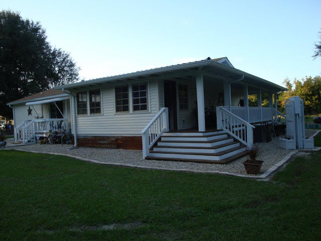 Double wide manufactured home with wrap around porch