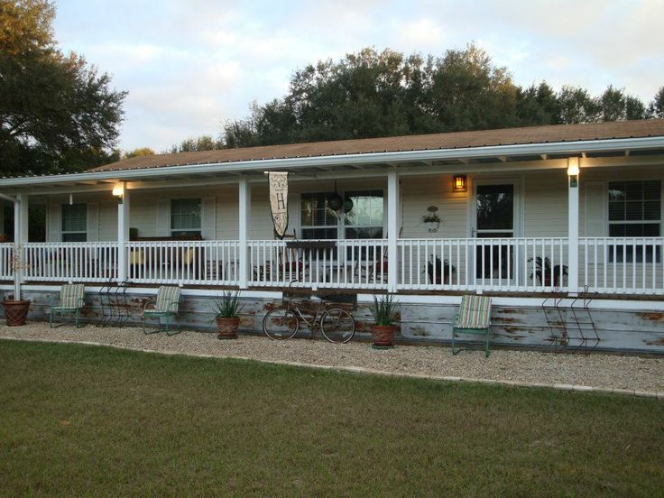 9 beautiful manufactured home porch ideas for Modular home with wrap around porch