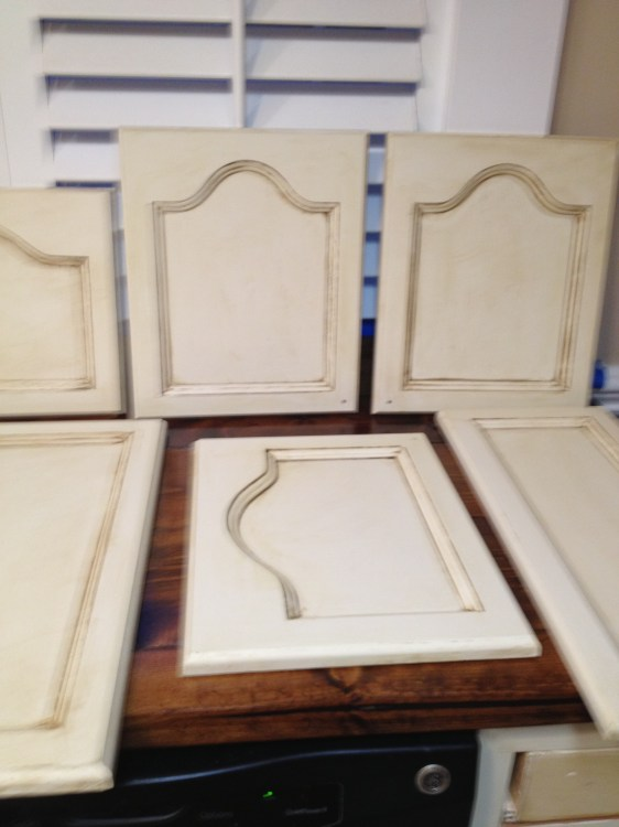 By painting and aging the kitchen cabinets they were able to create a