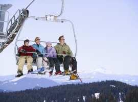 Mom, Dad, and Kids on Ski Lift