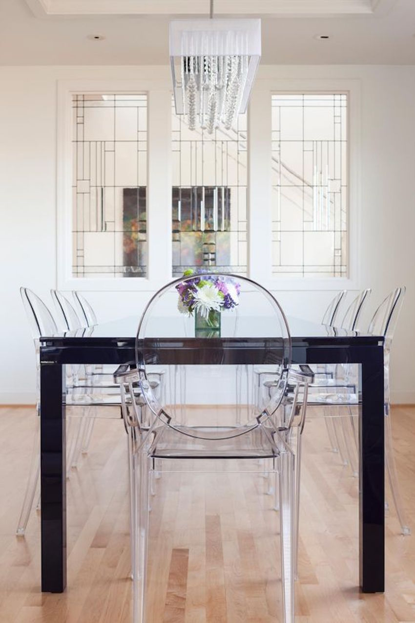 Fresh flowers and a bowl of fruit add a refreshing splash of color black dining tables 10 gorgeous black dining tables for your modern dining room 10