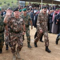 """A handout picture released by the Jordanian Royal Palace on March 2, 2016 shows Jordan's King Abdullah II (2-L), in the city of Zarqa, attending the funeral of Captain Rashed Zyoud, who was killed during a raid conducted in Irbid by Jordanian security forces on Islamic State (IS) group jihadists.   Jordan said that it had thwarted planned attacks by the Islamic State (IS) group on its soil, killing seven suspected jihadists in a major security operation near the Syrian frontier. The kingdom, which also borders Iraq, has for years struggled with homegrown Islamists and is part of a US-led coalition carrying out air strikes against jihadists. The operation, which began late March 1 in the northern city of Irbid was the most significant of its kind since Jordan joined the coalition in 2014. / AFP / Handout / RESTRICTED TO EDITORIAL USE - MANDATORY CREDIT """"AFP PHOTO / JORDANIAN ROYAL PALACE / YOUSEF ALLAN"""" - NO MARKETING NO ADVERTISING CAMPAIGNS - DISTRIBUTED AS A SERVICE TO CLIENTS ==="""