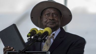 Uganda's President Museveni holds the bible during his swearing-in ceremony at the Independance grounds in Uganda's capital Kampala