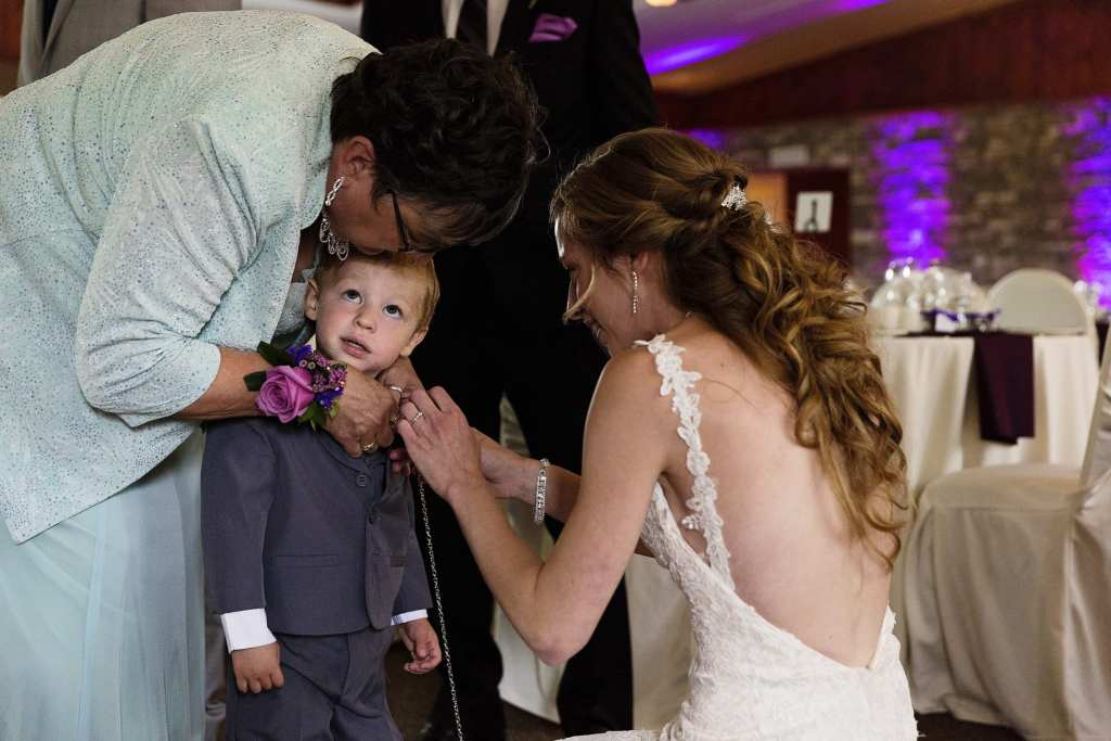 little boy having flowers adjusted ahead of Strathmere wedding ceremony