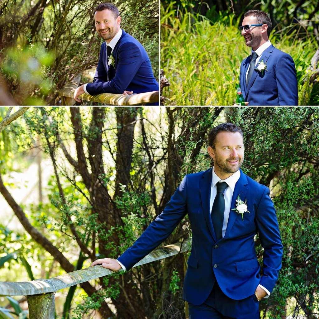 Cornwall international wedding photographer - groom in blue suit
