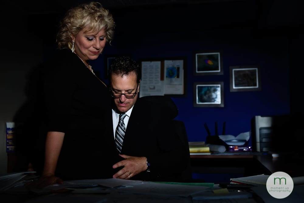 man touching woman's thigh in office
