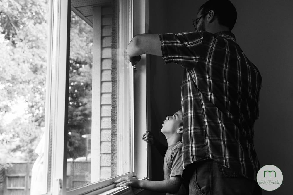 Cornwall Documentary Family Photography - Osborne 2boy struggling to open window