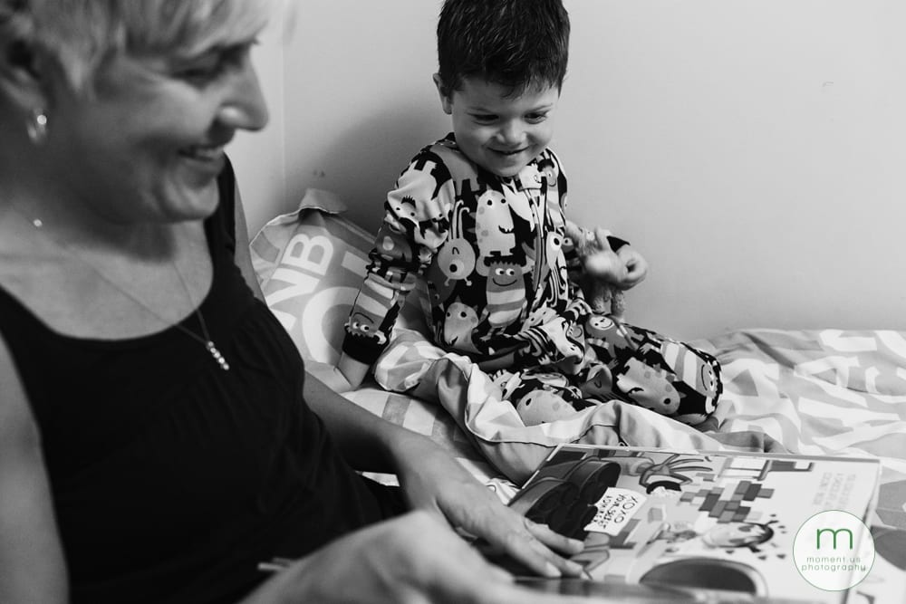 boy with mom on bed