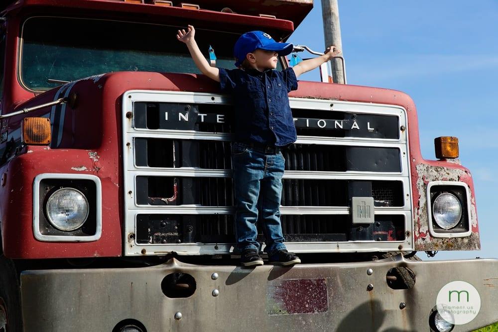boy standing on truck
