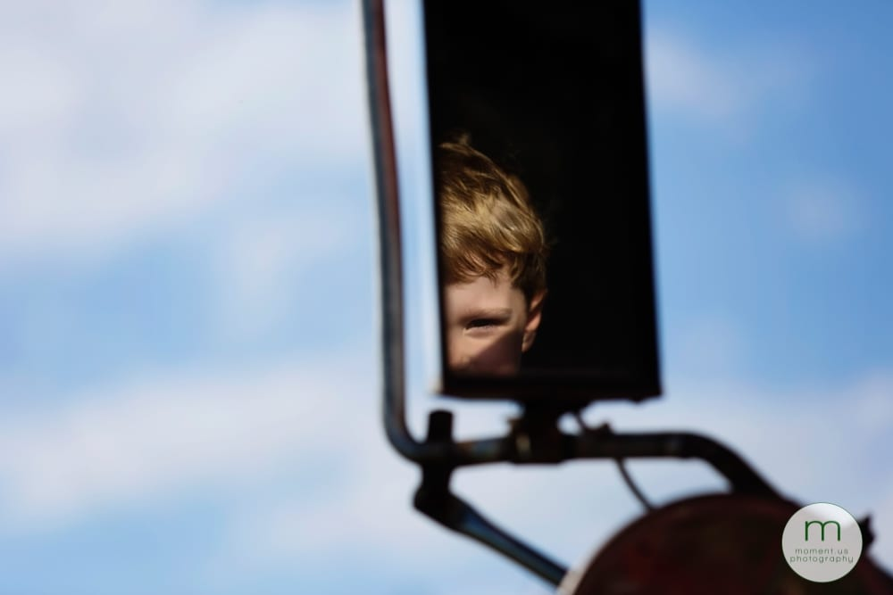 boy in wing mirror