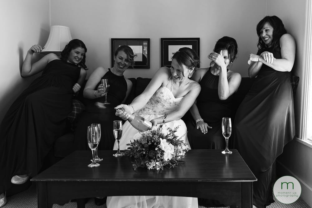bride popping champagne cork