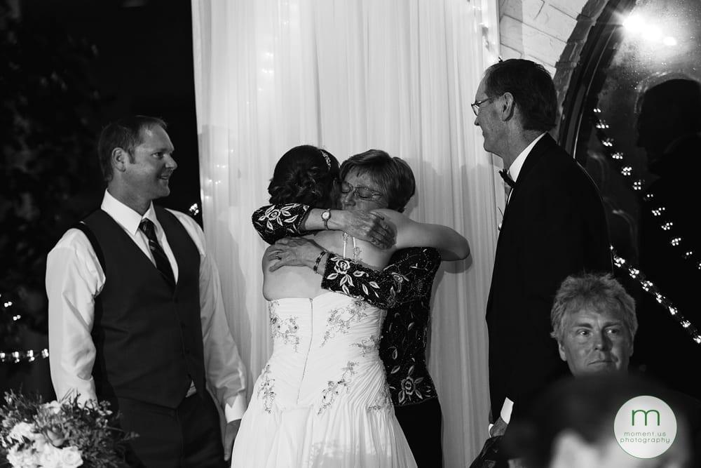 groom's mother hugging bride