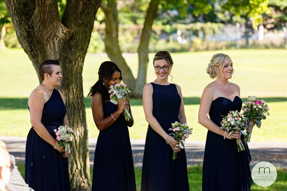 bridesmaid hiding in flowers