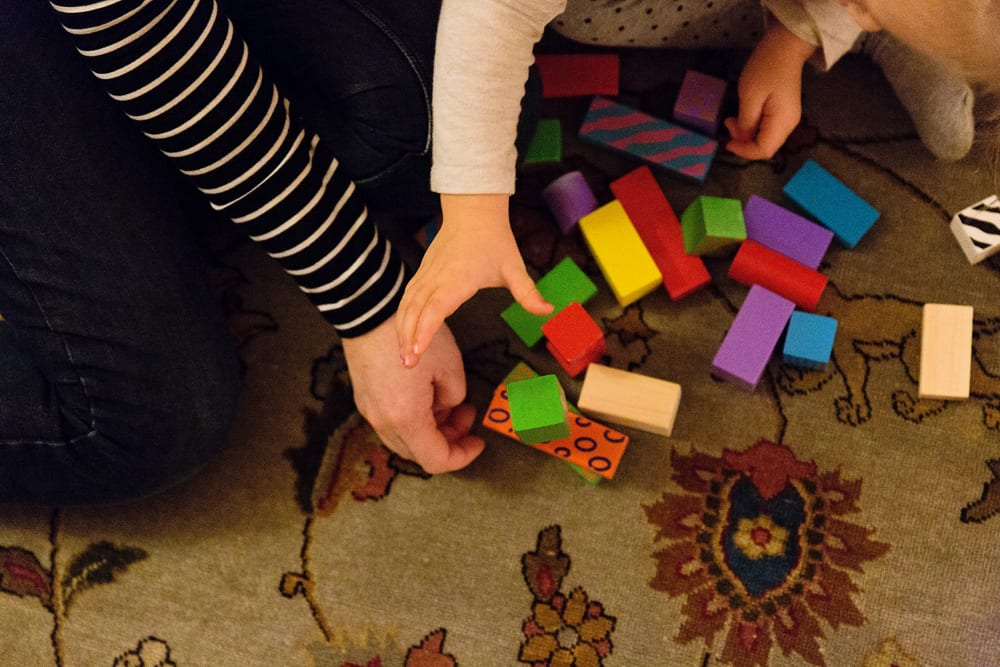 Stockholm mom and daughter playing with blocks