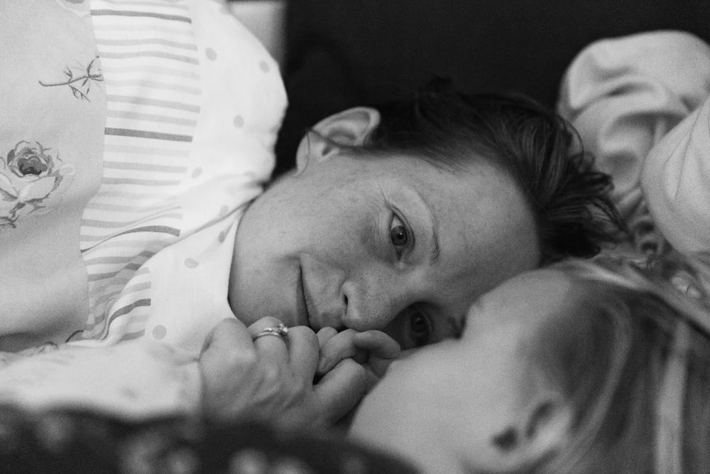 Stockholm mom in bed with daughter