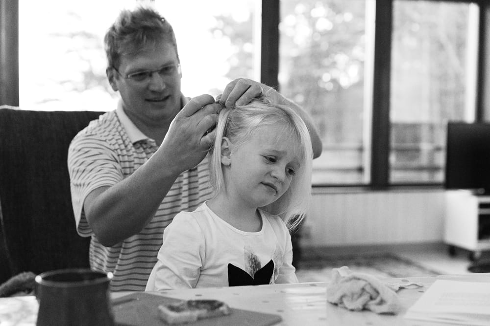 Stockholm girl getting hair done by dad