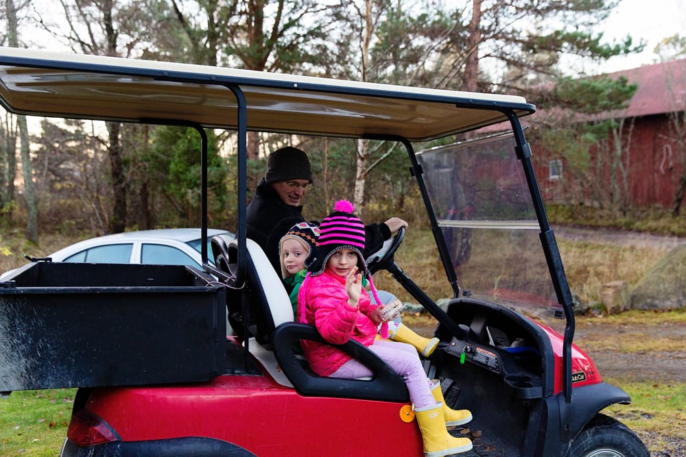 girls leaving for school on golf cart