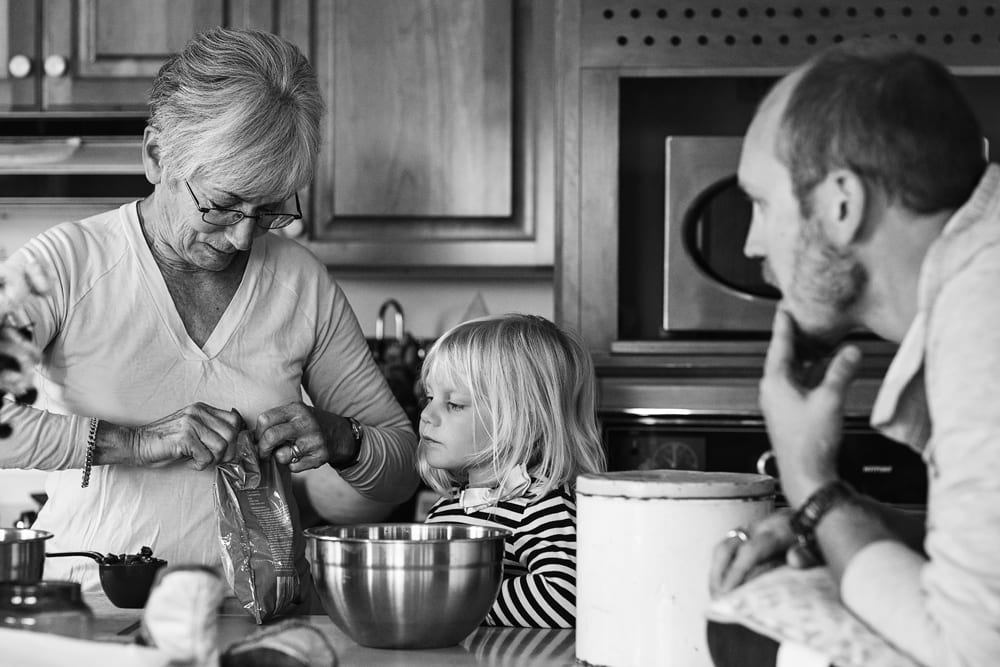 Cornwall family photographer - baking with grandma