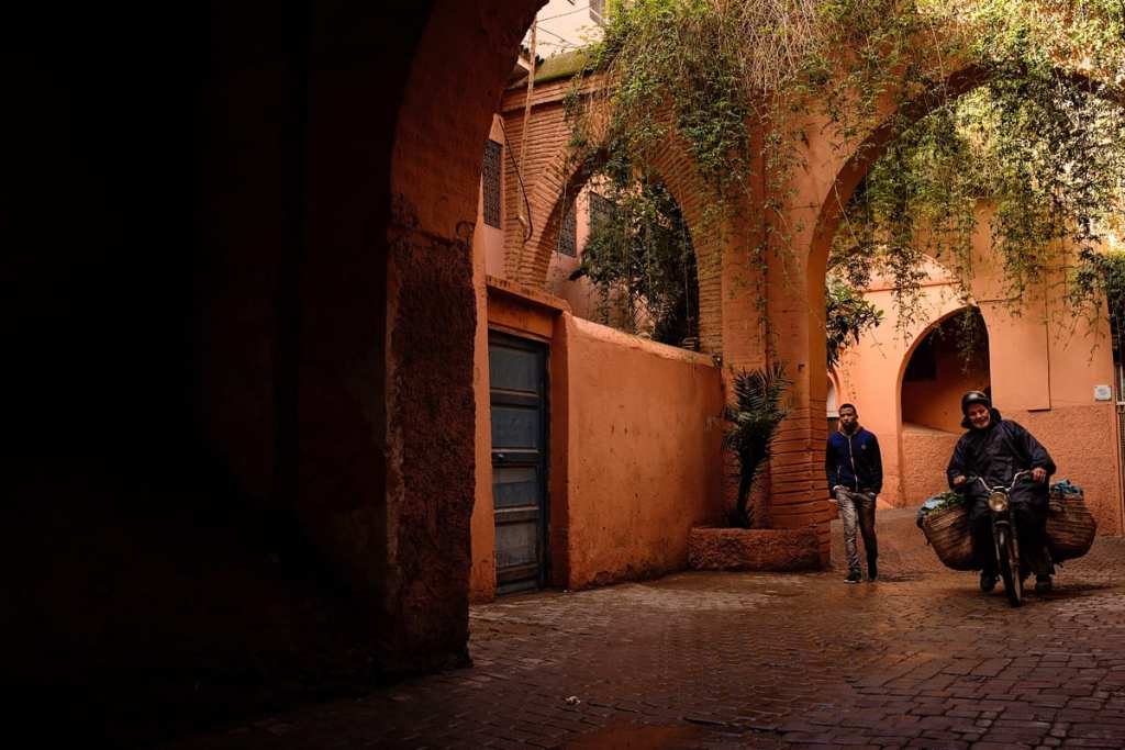 Wedding photographer in Morocco - pedestrian and cyclist under archway