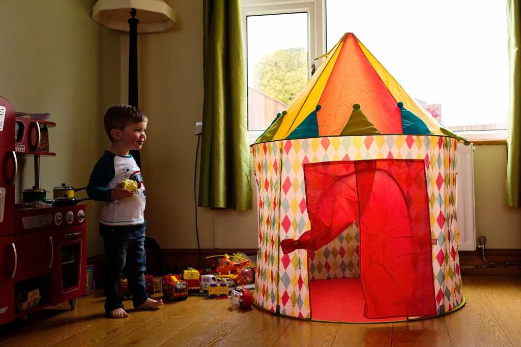 boy looking at play tent