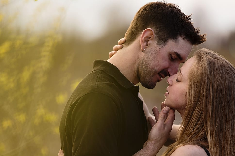 man about to kiss woman during Cornwall engagement session