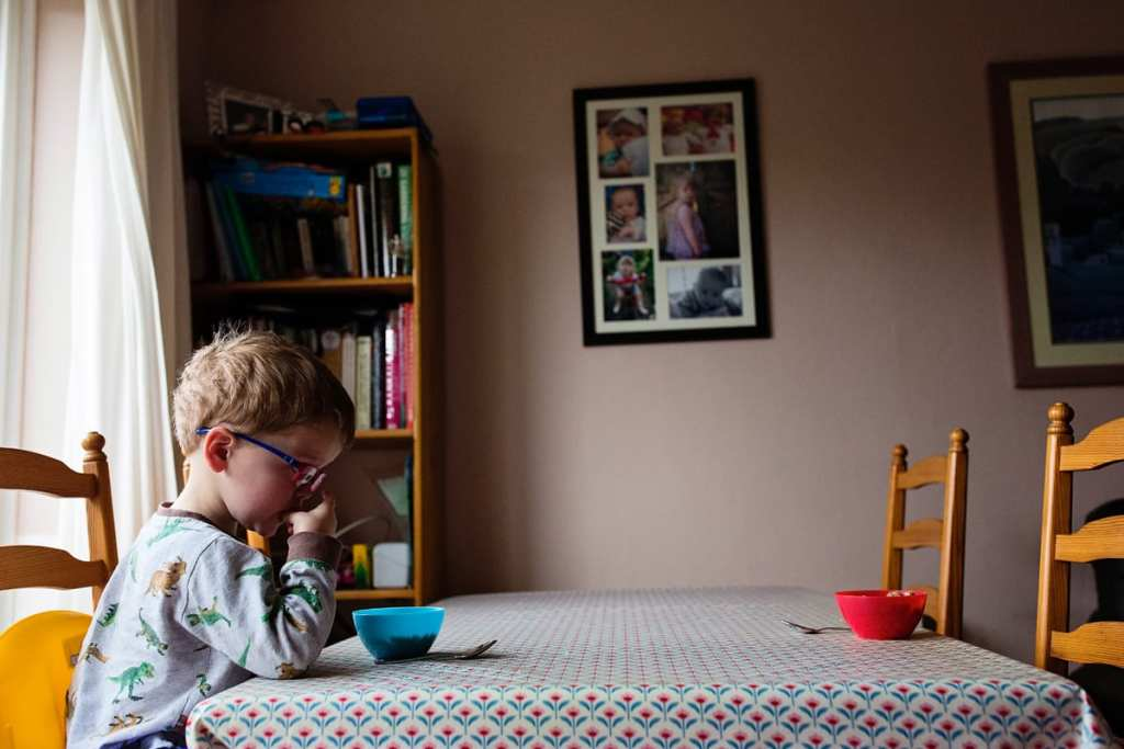 boy eating breakfast alone