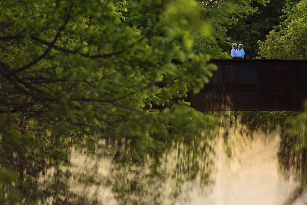 couple standing together on bridge for Williamstown engagement session