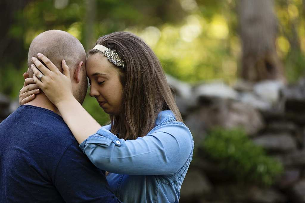Woman cuddles up to fiance during St Raphael's engagement session