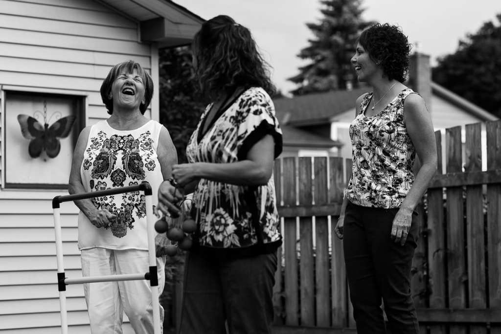 mom and daughters in floral shirts playing summer games