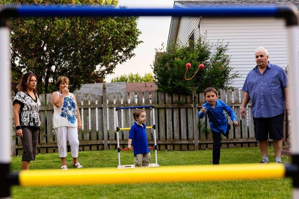 boys in backyard playing summer games