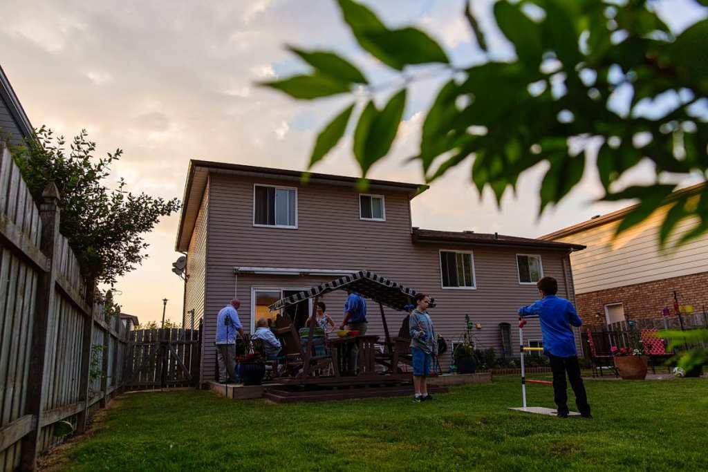 candid summer backyard family gathering