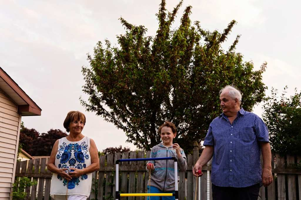 boy playing summer games with grandparents