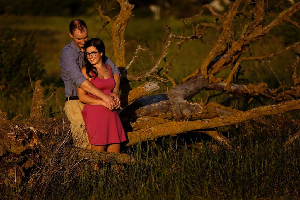 Couple leaning on old tree in Rural Ontario Engagement session
