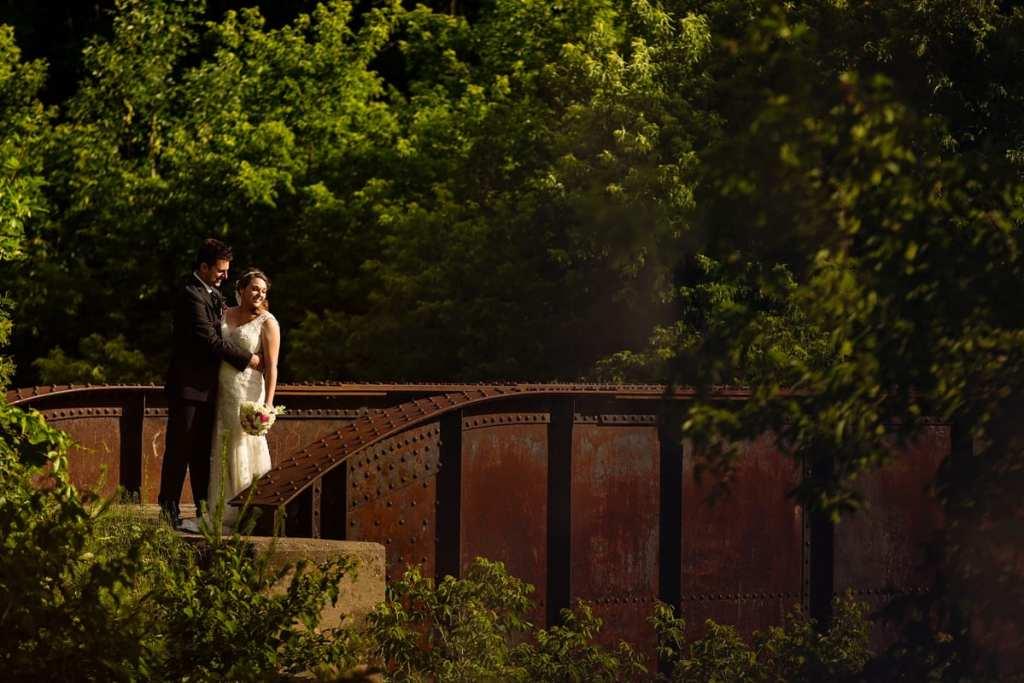 Bride and groom in sunset photo on Williamstown bridge