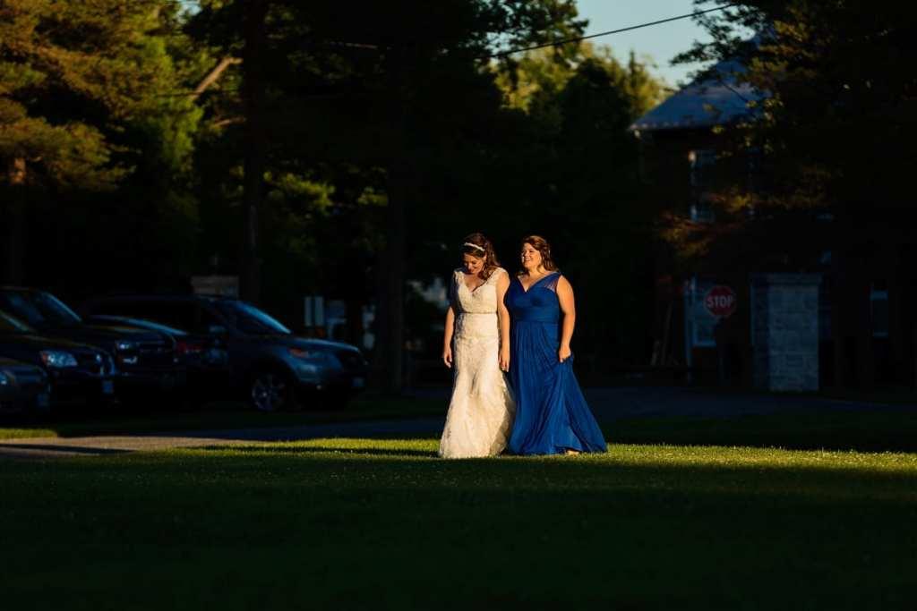 Bride and bridesmaid in blue chiffon dress at Williamstown fairgrounds wedding