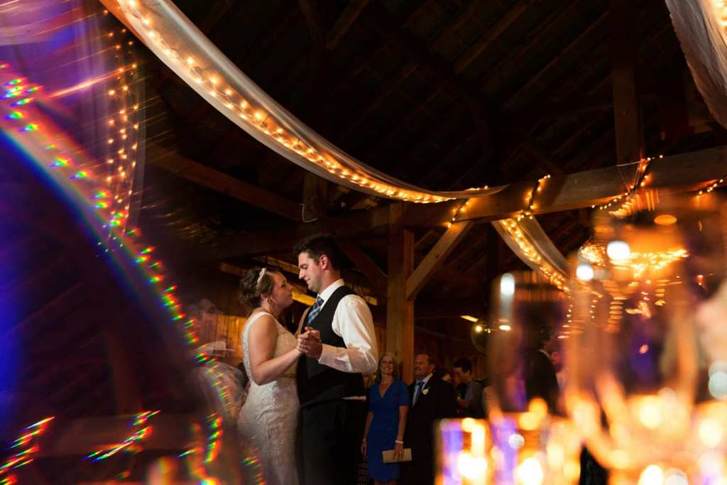 Bride and groom first dance in rustic barn reception venue